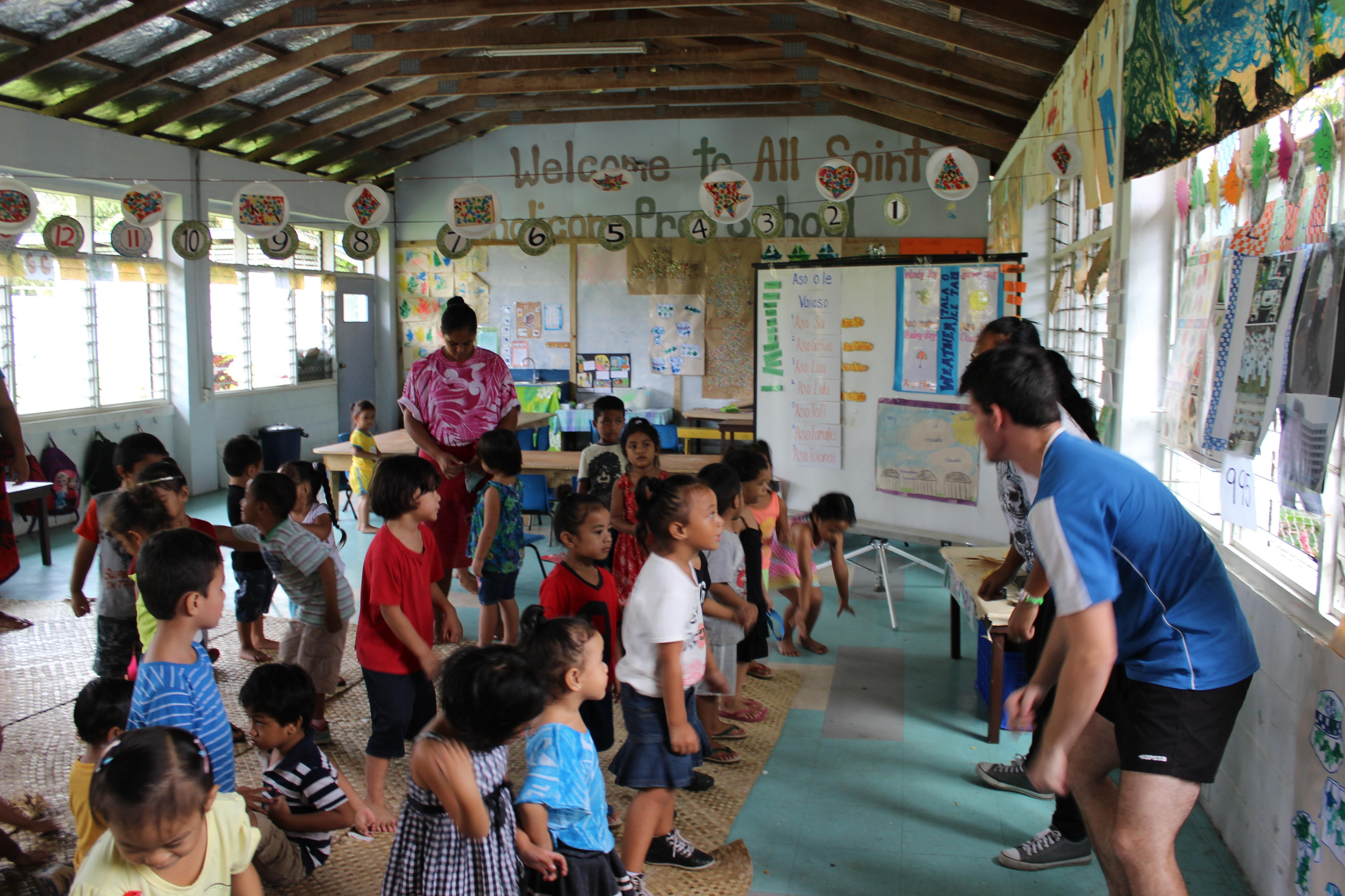 Projects Abroad volunteers teach a fun physical game to children to get them active and moving in Samoa.